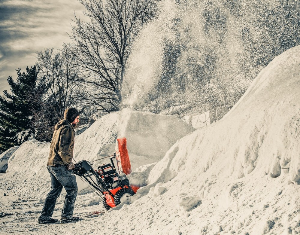 Person using a snowblower